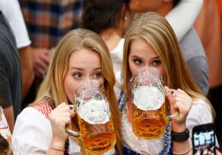 Two women get a taste of the festivities during the opening day of the Oktoberfest in Munich