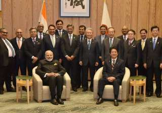 PM Narendra Modi and his Japanese counterpart Shinzo Abe in a group photo with the members of India-Japan Business Leaders' Forum in Tokyo, Japan on Friday.