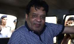 When picked up, Iqbal Kaskar was watching KBC, eating