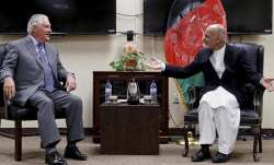 Rex Tillerson speaks with Ashraf Ghani at the Bagram Air