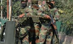 Security forces stand guard in south Kashmir.
