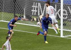 Italy's Giorgio Chiellini celebrates after scoring opening