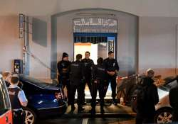 Policemen secure the area in front of the Islamic centre