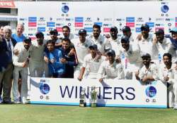 Indian cricket team and support staff after defeating- India Tv