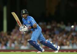 Virat Kohli of India playing a drive on the ON side.