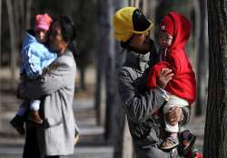 china abolishes re education camps eases one child policy