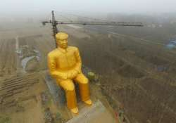 china destroys mao s giant gold painted statue worth 4.6