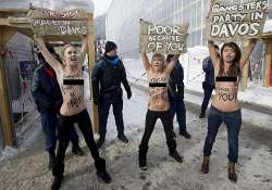 topless ukrainian women stage protest at world economic