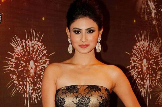 After a hectic schedule, Mouni Roy just can't resist hitting her bed ...