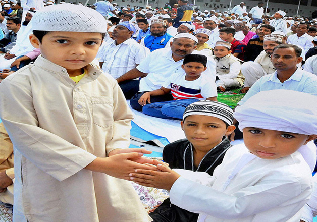 Children greet each other on the day of Eid al-Adha at the beach in Mangalore, Karnataka.