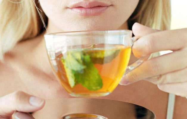 Instead of taking caffeine in the form of tea or coffee, take green tea. Generally, ladies think consuming caffeine will help them stay active and energetic during the day. This is not the healthy option. It might strip off the body's moisture leaving you dehydrated. Green tea is not only good for your skin but rejuvenates stomach also.