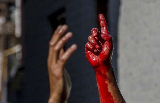 In Srinagar, Kashmir a Shiite Muslim can be seen raising his blood-stained hand. Shouting religious slogans is a common sight in Muharram processions.
