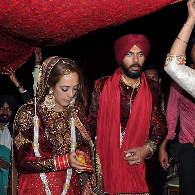 The newlywed couple left the gurudwara as the relatives cover them with a phulkari.