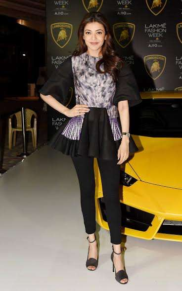 Kajal Aggarwal chose a black attire with a dash of purple on the top. The lady looked gracious as always.