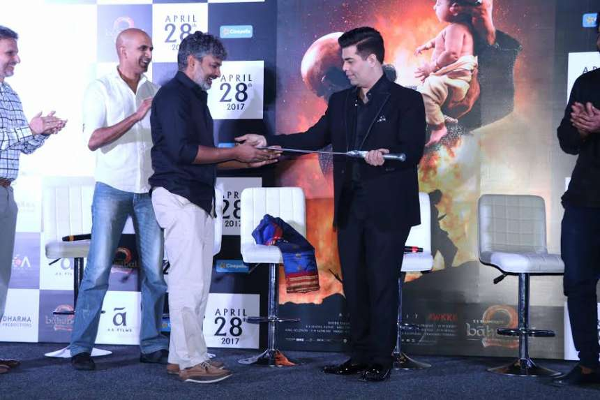 'Baahubali 2' team gifted a sword to director Karan Johar, who was elated and said that it was the best gift for his children. He also expressed his happiness to be associated with the film.