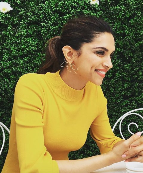 Deepika wore a yellow figure-hugging dress with wide sleeves for her first look on the second day at Cannes Film Festival. The actress looked nothing less than a beautiful dream come true in the pictures.