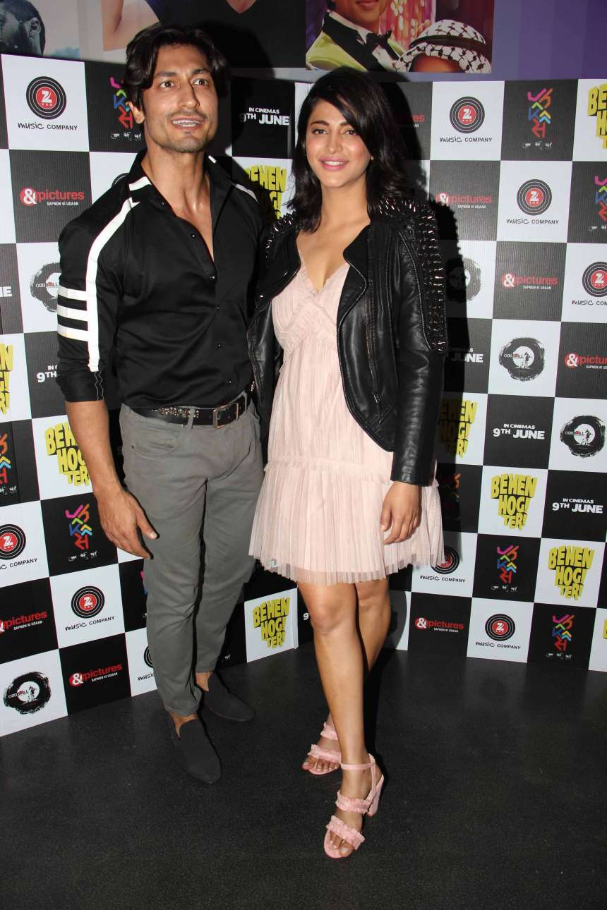 Shruti Haasan and Vidyut Jamwal during the screening of the upcoming Bollywood movie Behen Hogi Teri. Shruti wore a peach dress with black spike Studded Shoulder Leather Jacket, whereas Vidyut wore Black shirt with white stripes and grey trousers for the screening.