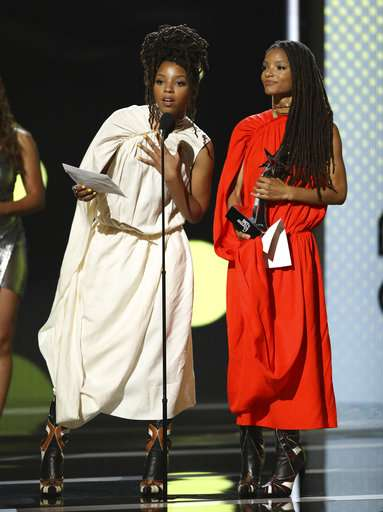 Chloe Bailey, left, and Halle Bailey accept the Viewer's Choice award on the behalf of Beyonce at the BET Awards at the Microsoft Theater.