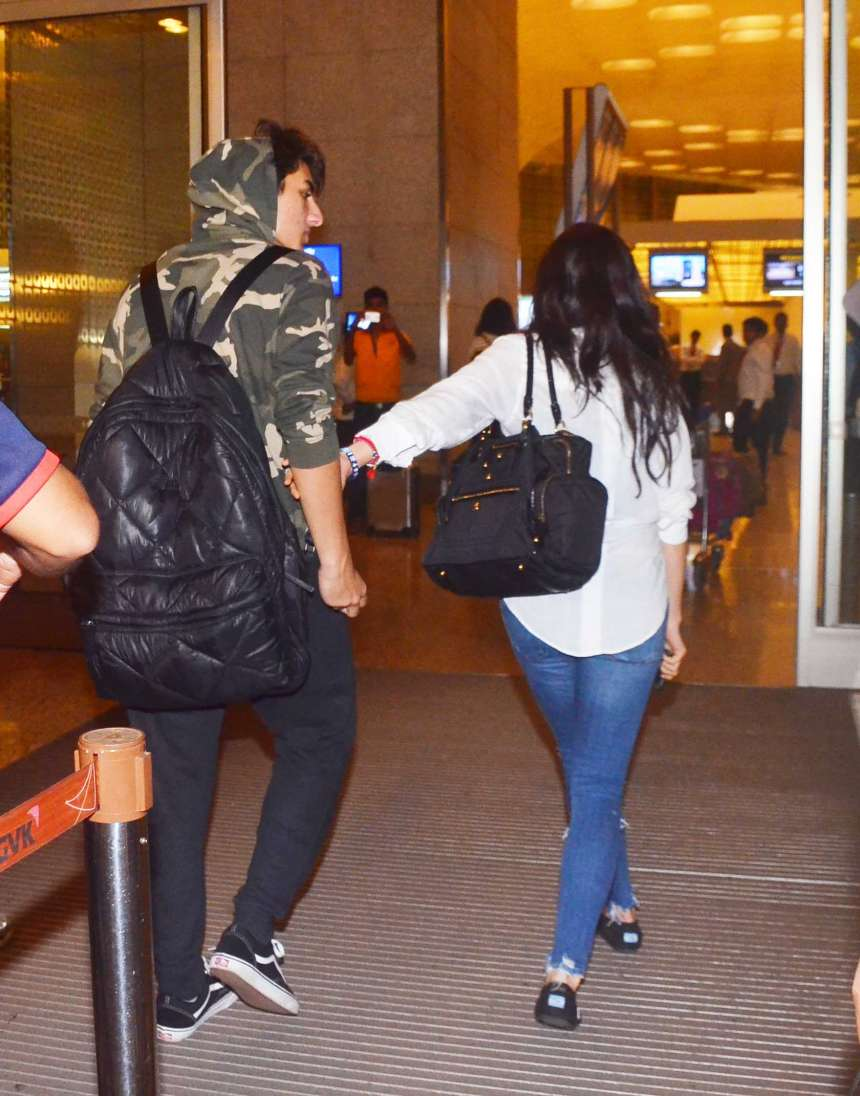 Sara is a doting sister as she holds the hand of her younger brother Ibrahim at the airport.