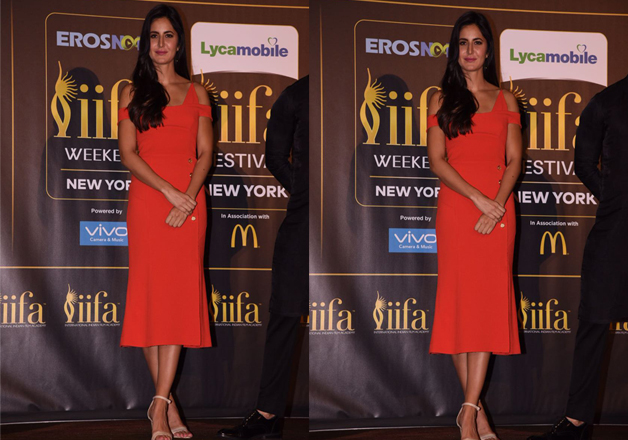 Katrina Kaif sizzled at IIFA 2017 event in an orange body fit dress.