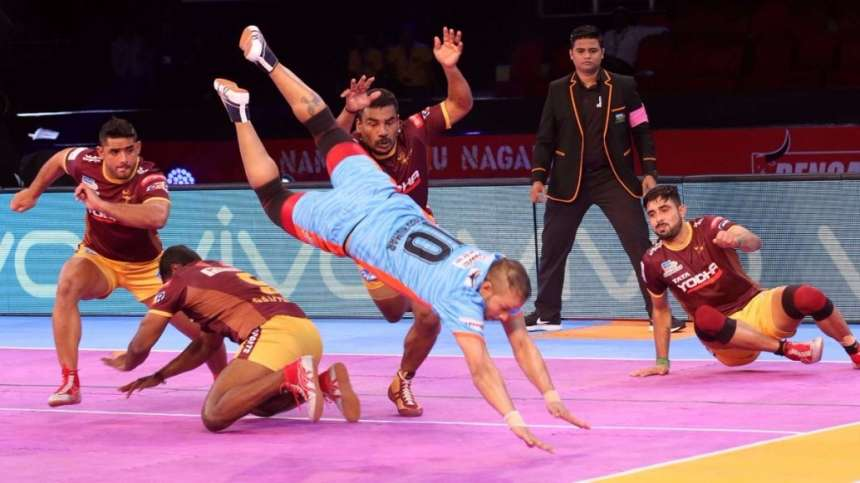 Bengal Warrior's raider dives away from the Yoddha's defence to claim a point in the match.