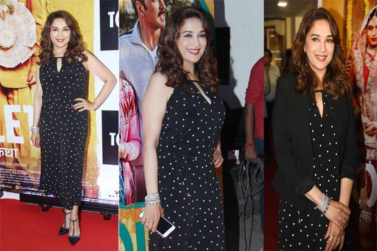 Bollywood actress Madhuri Dixit graced the event in a black bobby print one-piece dress. She paired it with a black jacket and as usual the diva the looking gorgeous at the event.
