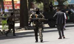 Security personnel patrol near a park where a would-be
