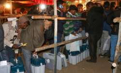 Election officers stand in queue for submission of their