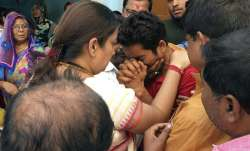 BJP MP Smriti Irani consoles the family members of former