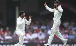 Kuldeep Yadav of India celebrates dismssing Travis Head of