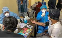 A file photo of people being checked for coronavirus