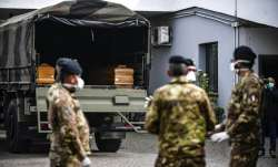 Italian army soldiers wait for coffins they took from the Bergamo area, where the coronavirus infect