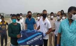 Indian cricketer Shikhar Dhawan gifting a cricket kit