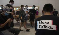 A visitor to an Apple store wears a t-shirt promoting Tik