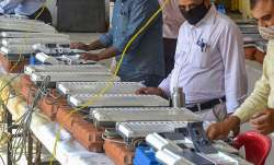 Poll officials check Electronic Voting Machines (EVMs)