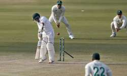 Pakistan's batsman Abid Ali, center, is bowled out by South