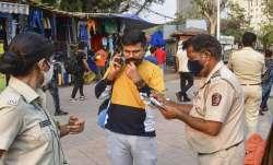 BMC officials penalise a commuter for not wearing masks,