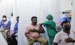 People are administered COVID-19 vaccine in Mumbai.