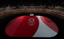 The floor of Olympic Stadium is lit before the start of the