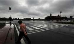 A man walks in the rain in New Delhi. The monsoon rains