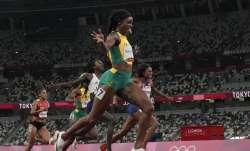 Elaine Thompson-Herah, of Jamaica, wins the final of the