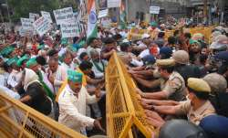 Police try to stop the farmers protesting over their