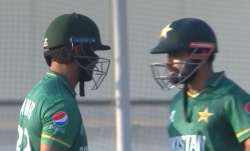 Pakistan's Fakhar Zaman (left) and Babar Azam in action against West Indies during T20 World Cup mat